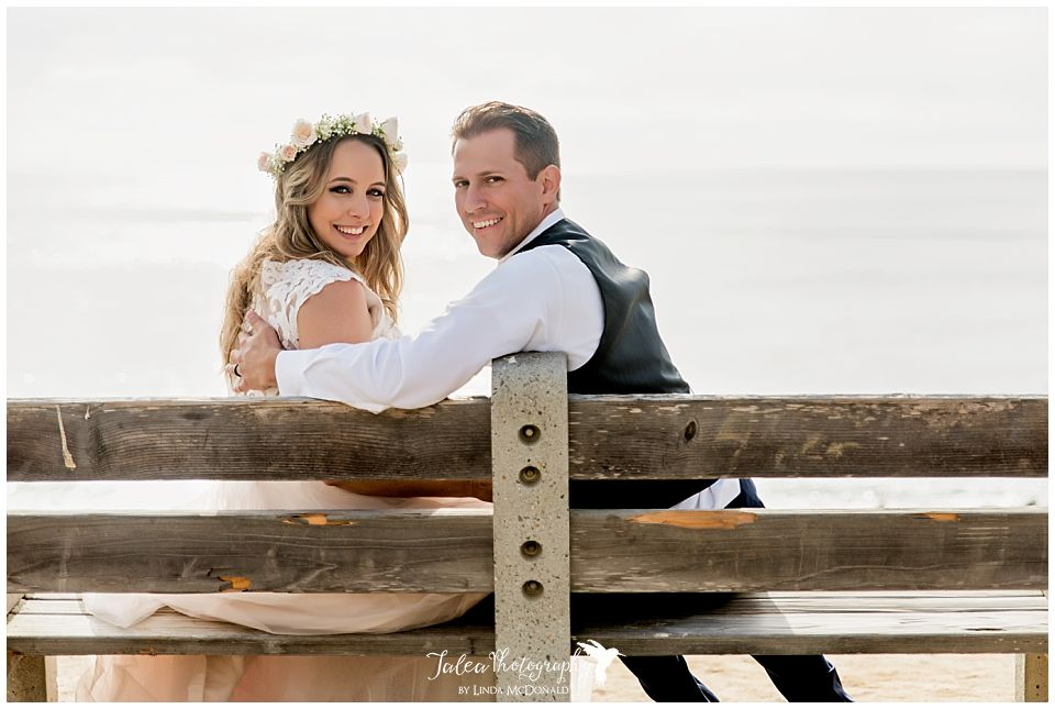 wedding-bowl-la-jolla-bride-groom-looking-at-camera