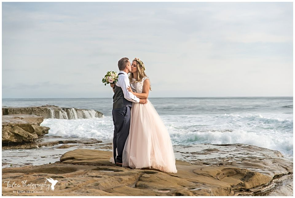 wedding bowl la jolla bride groom kissing on beach