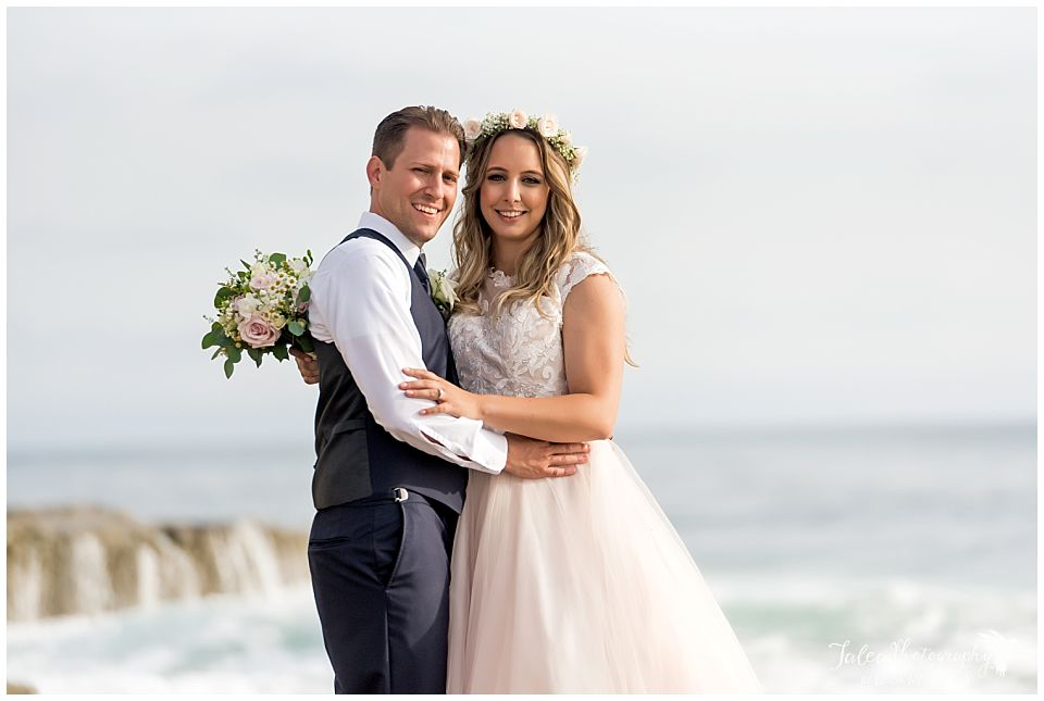 bride groom posing in front of beach la jolla wedding ceremony