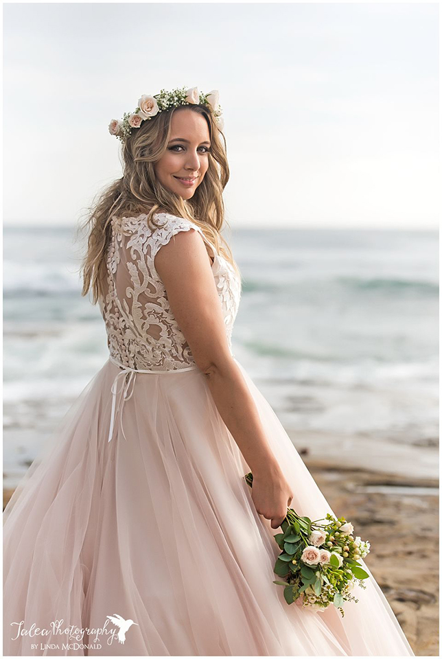 bride standing on beach with bouquet cuvier park wedding
