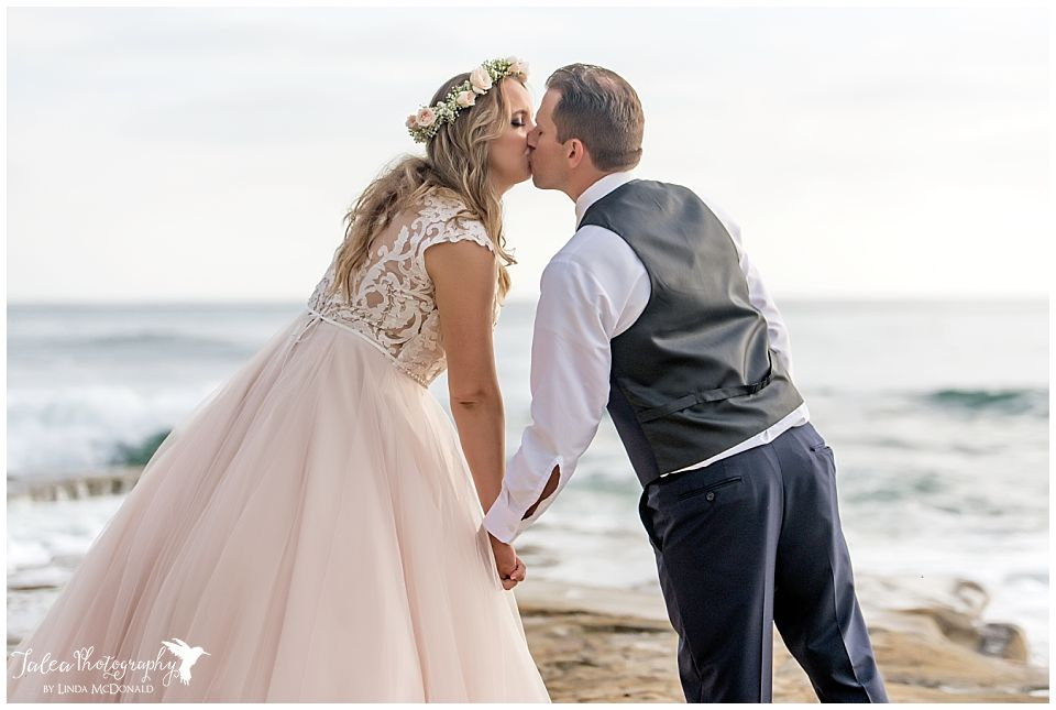 la jolla wedding ceremony bride groom kissing in front of beach