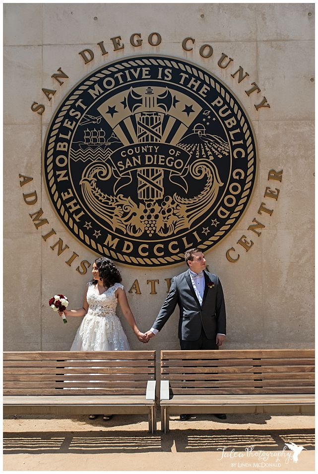 couple-posing-under-san-diego-county-administration-building-sign