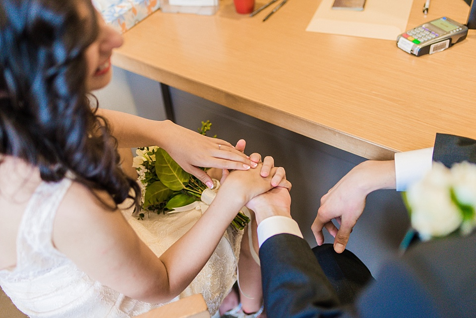 bride and groom holding hands at san diego county administration center