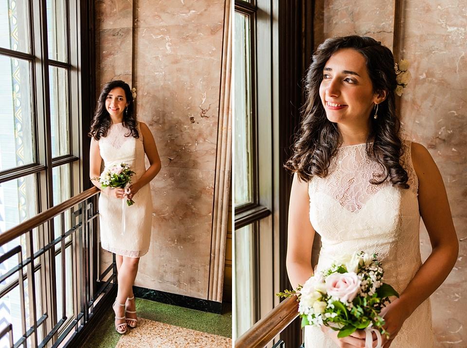 bride posing next to the window san diego courthouse wedding photographer