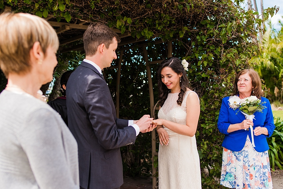 groom placing ring on brides finger san diego courthouse wedding photography