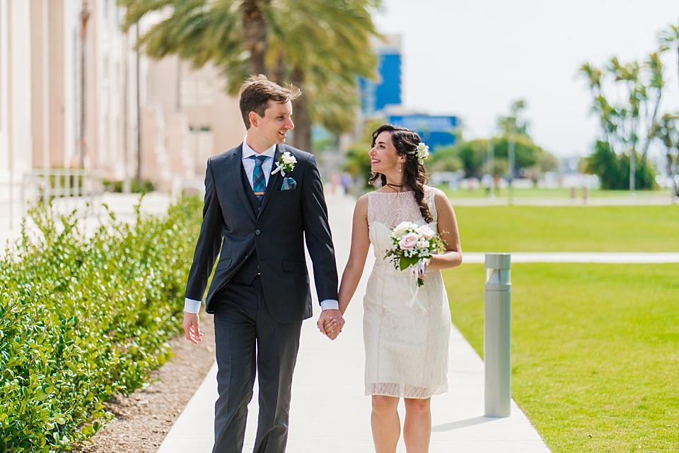 wedding couple walking at san diego county administration building