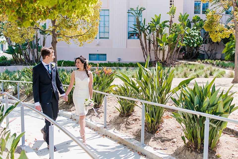 newlyweds taking a walk san diego courthouse civil marriage ceremony