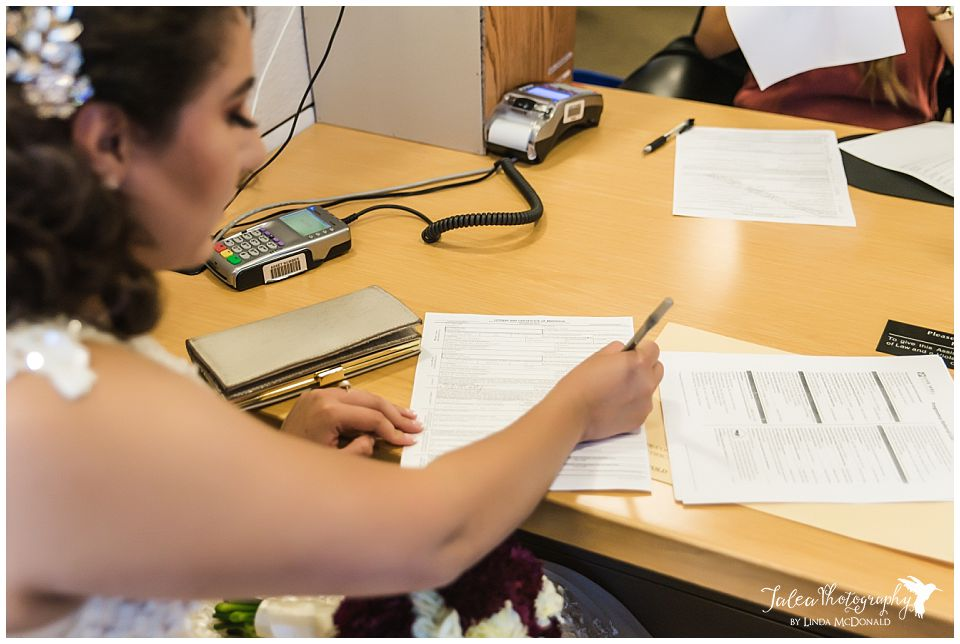 bride-filling-out-application-for-san-diego-marriage-license