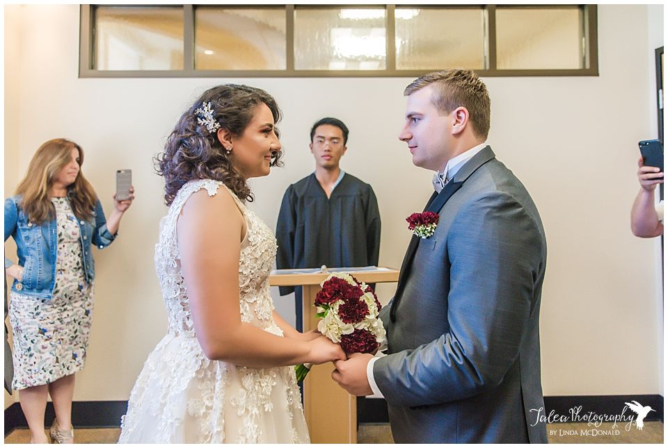 couple-facing-each-other-at-alter-san-diego-courthouse-wedding