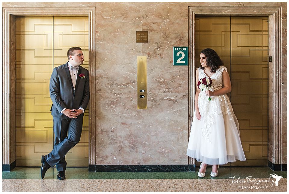 groom-pretending-to-kiss-bride-san-diego-courthouse-downtown