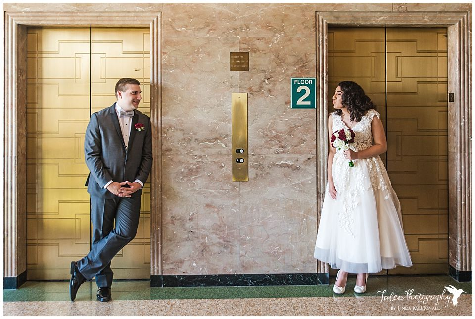 bride-pretending-to-kiss-groom-san-diego-courthouse-downtown
