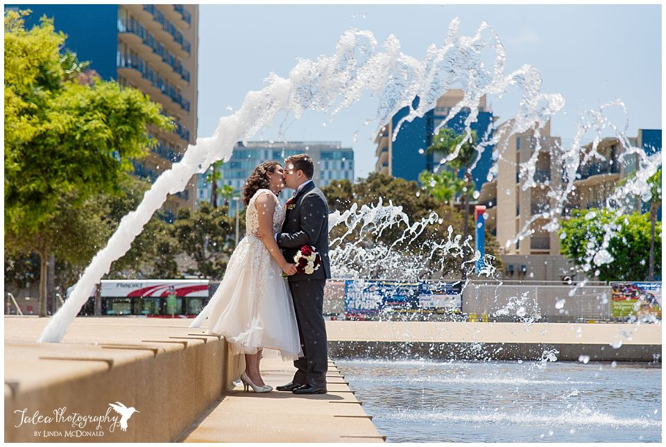 newlyweds-kissing-under-fountains-san-diego-courthouse-weddings