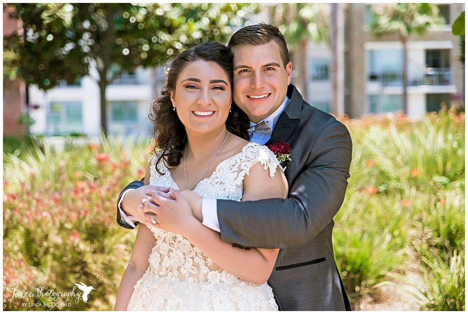 bride-groom-posing-at-san-diego-county-courthouse
