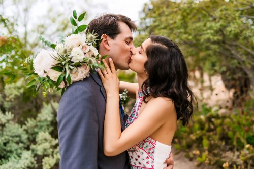 wedding couple kissing at san diego balboa park cactus garden