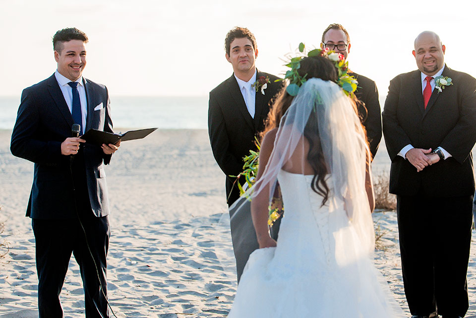 groom sees bride for the first time at coronado beach wedding
