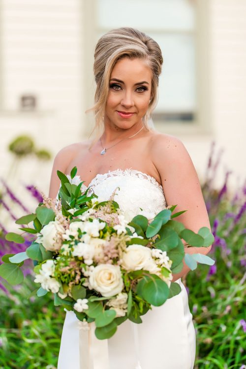 bride posing with bouquet at martin johnson house wedding la jolla