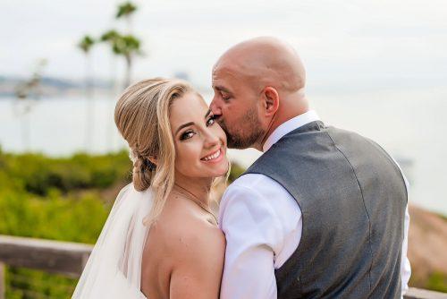 groom kissing bride martin johnson house la jolla wedding