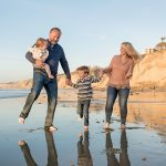 family dancing during portait session in San Diego with Jalea Photography
