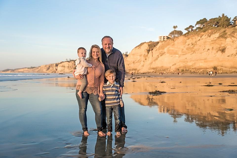 san diego family posing on the beach in la jolla
