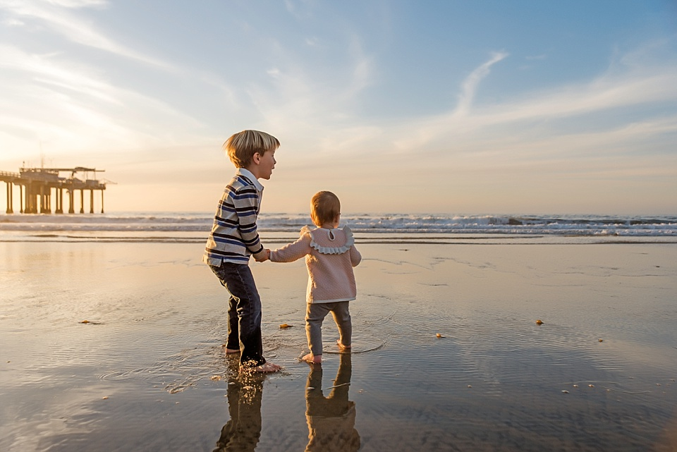 little boy and girl holding hands and looking at beach la jolla family photographer