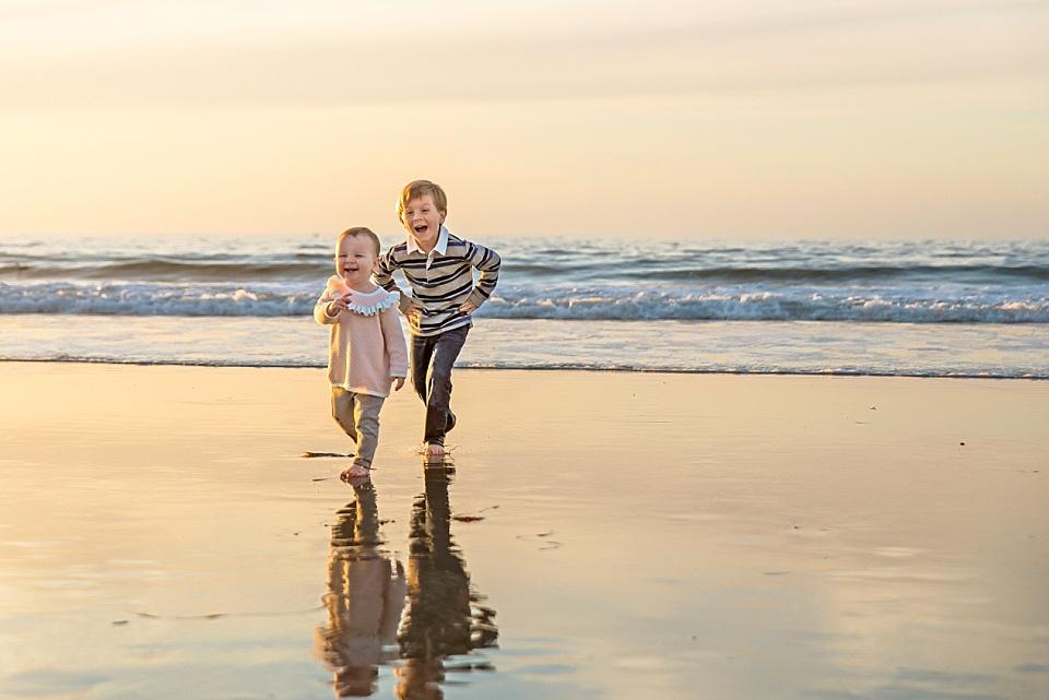 little kids playing on sand at La Jolla beach