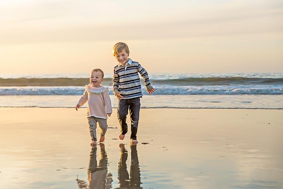 little children running on San Diego beach