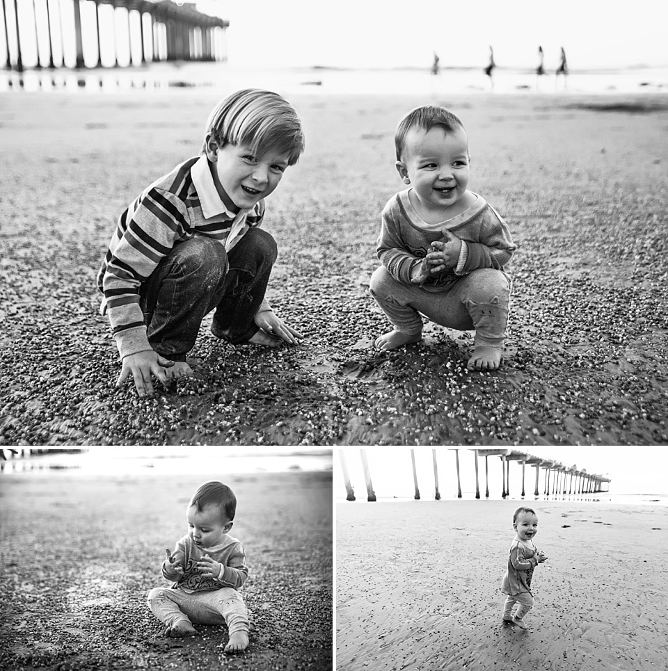 black and white photos children playing in sand at scripps pier la jolla