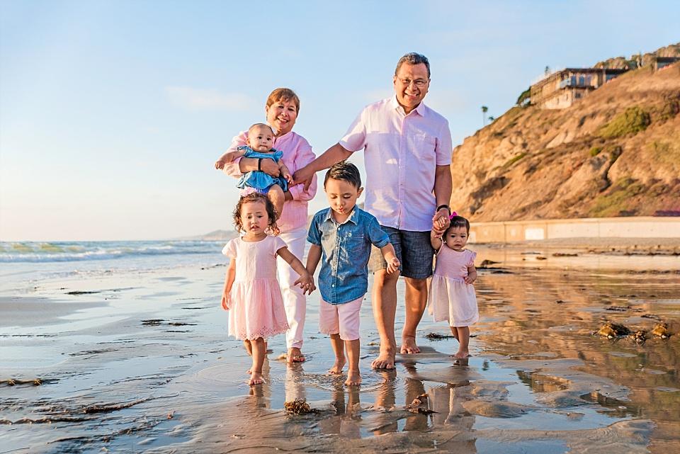 grandparents walking with grandchildren san diego beach photography