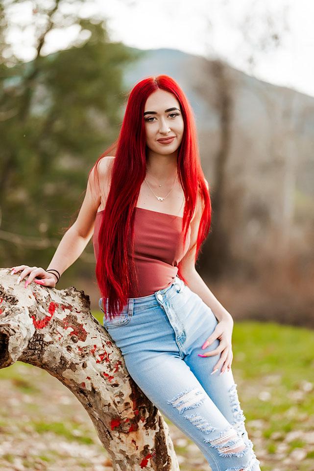 senior girl posing in rustic location san diego
