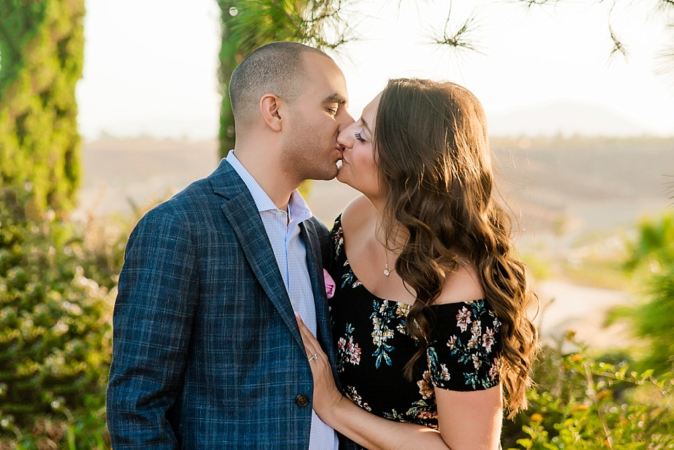 portrait of couple kissing at carter estate winery