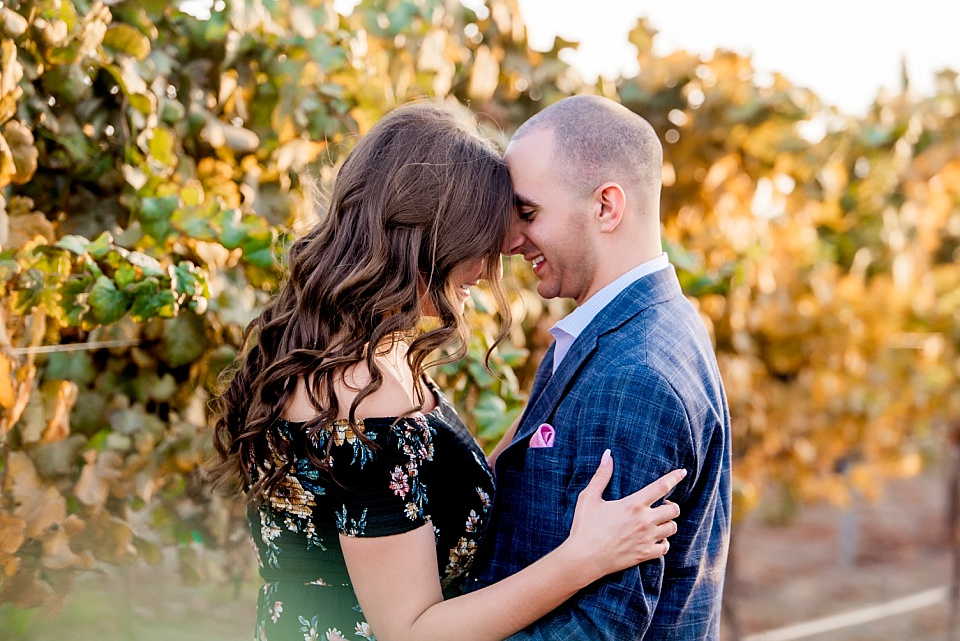 couple sharing a romantic moment at carter estate winery vineyard