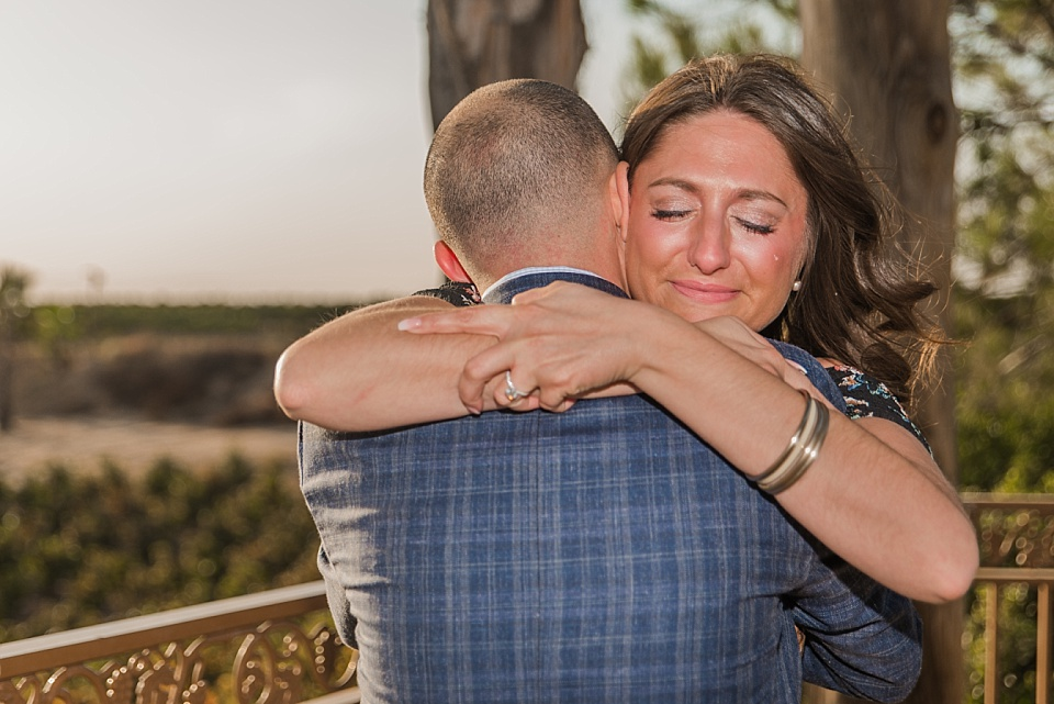 tearful female embracing male during winery wedding proposal