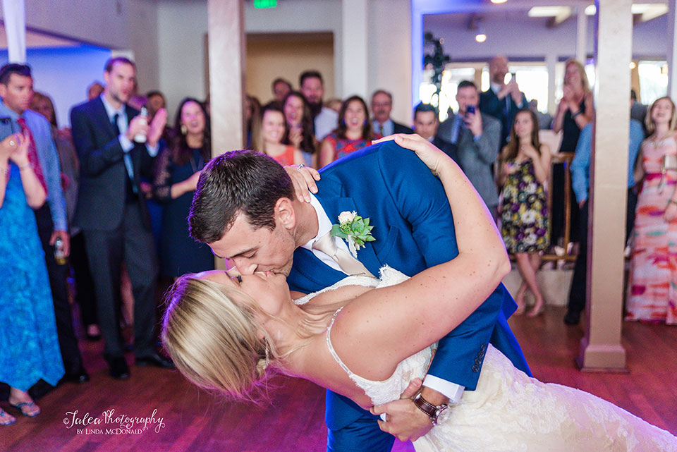 groom-dipping-bride-during-first-dance-Jalea-Photography