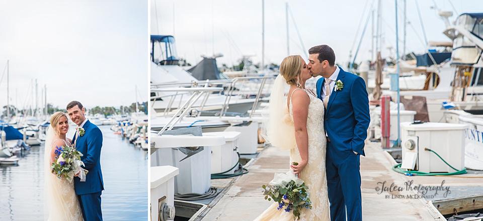 bride-and-groom-kissing-on-docks-at-Marina-Village-San-Diego
