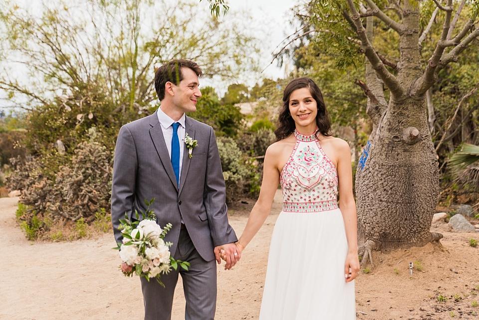 newlyweds walking at balboa park cactus garden