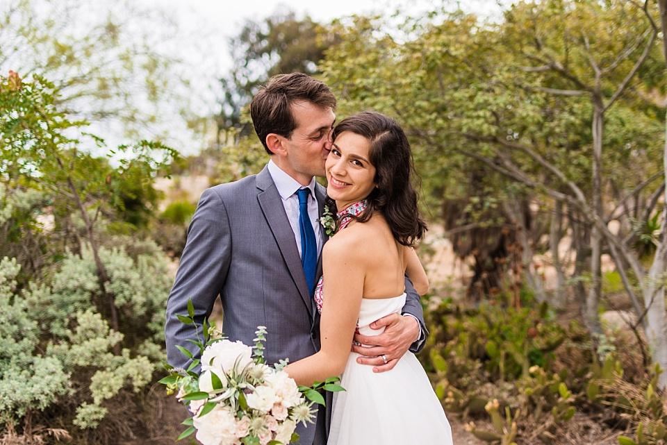 groom kissing bride desert cactus garden san diego