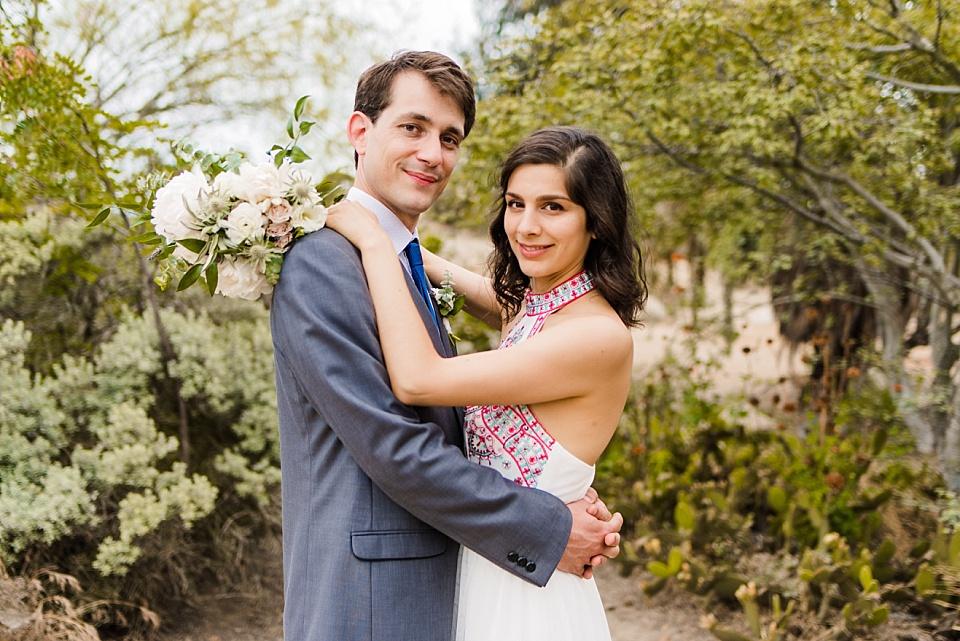 bride and groom posing at balboa park cactus garden