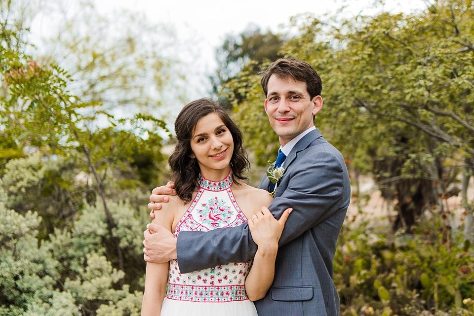 bride and groom embracing cactus garden balboa park