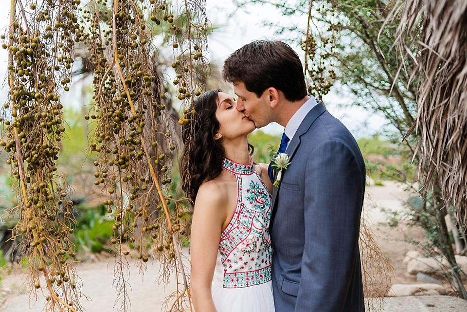 couple kissing at old cactus garden balboa park