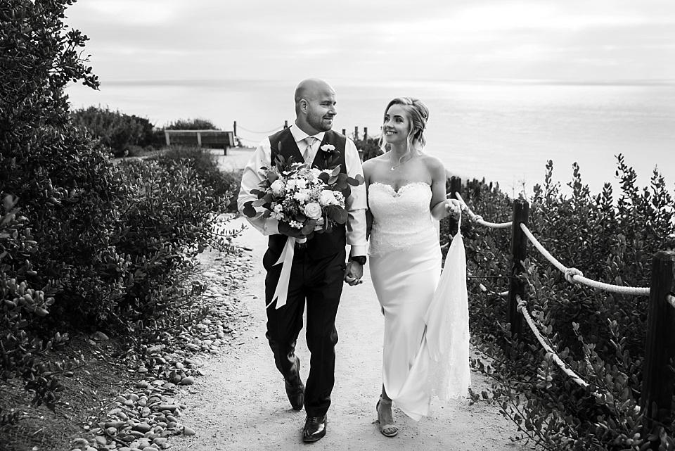 newlyweds walking on path martin johnson house wedding
