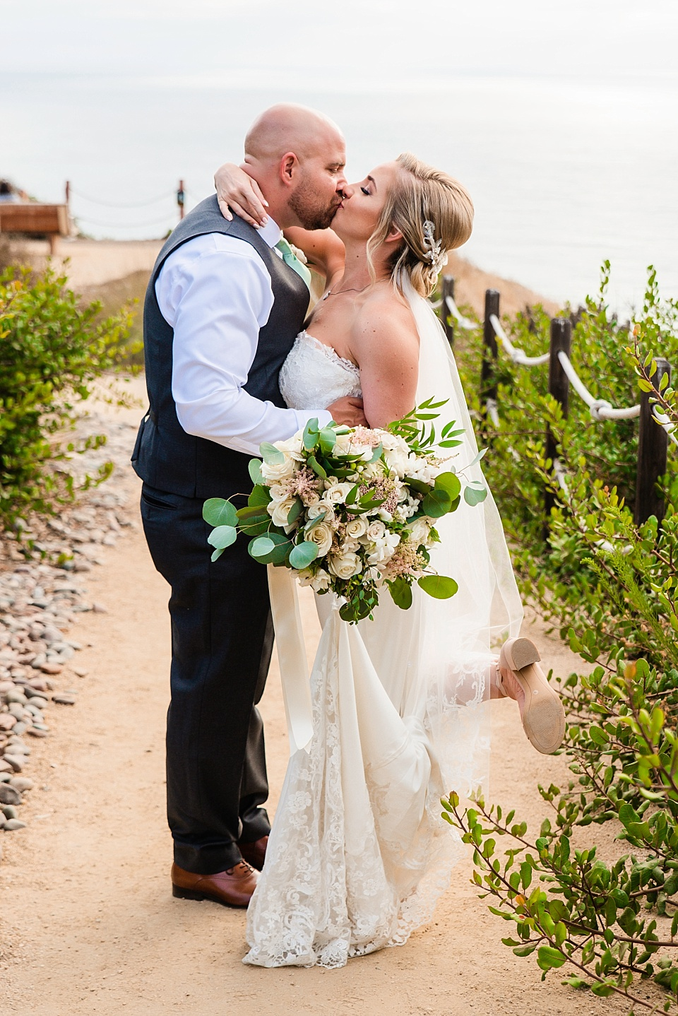 newlyweds kissing best outdoor wedding venue san diego