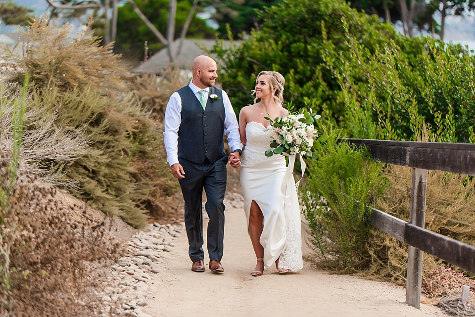 bride and groom walking on path outdoors venues san diego