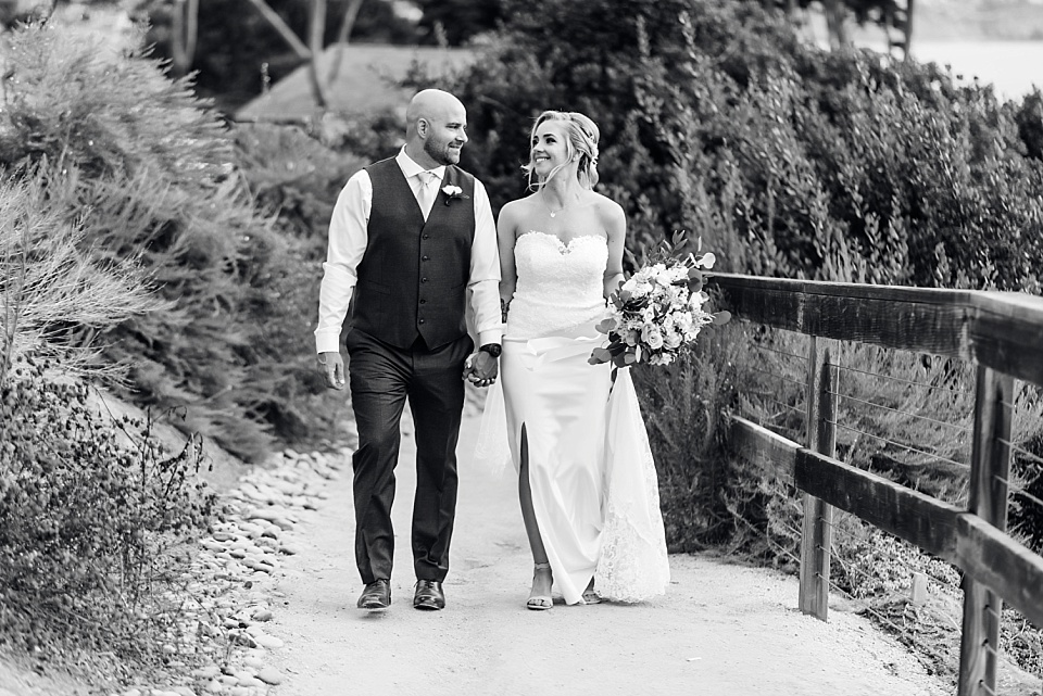 bride and groom walking at martin johnson house