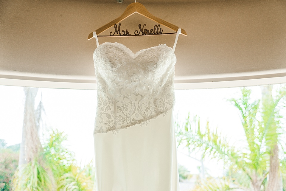 wedding dress hanging in window la jolla beach wedding venue
