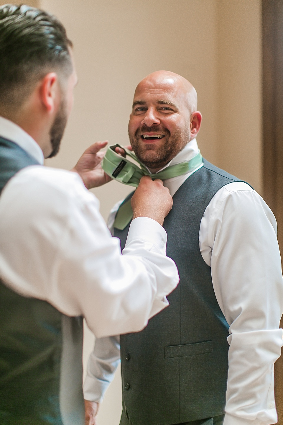 groom getting assistance with tie before the wedding la jolla wedding photography