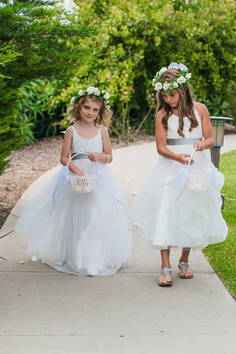 flower girls walking on pathway at the martin johnson house