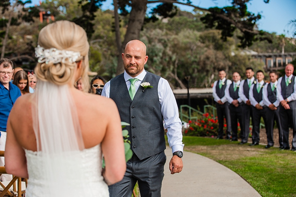 groom meeting bride in the aisle san diego wedding