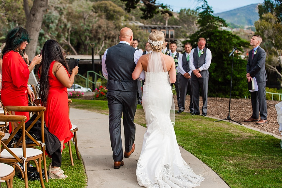 groom escorting bride down the aisle la jolla outdoor wedding