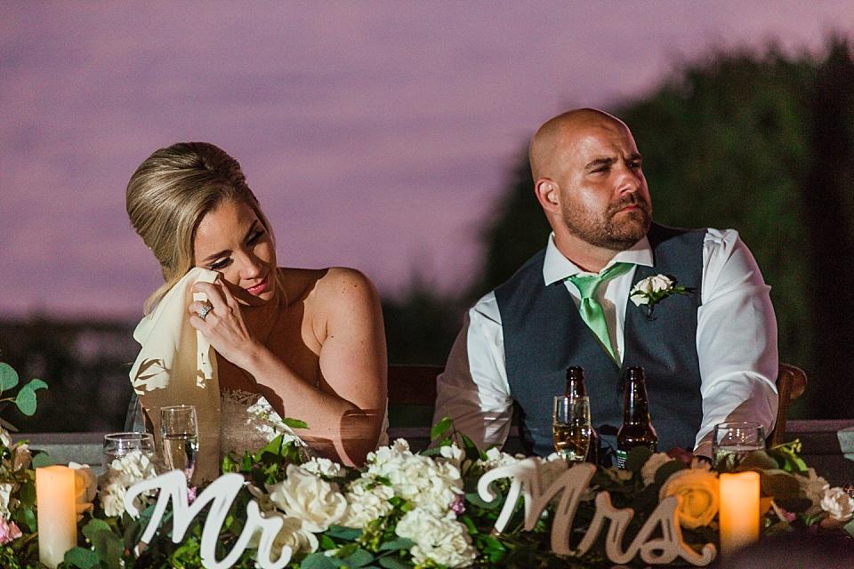 bride wiping away tear wedding reception photography la jolla wedding