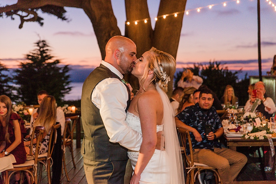 bride groom kissing during first dance outdoor wedding venues in san diego